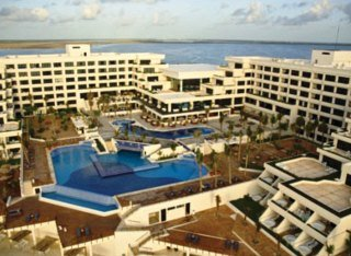 check rates at the Grand Oasis Playa hotel Cancun Mexico